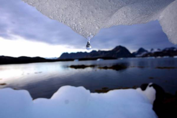 "Water drips from an iceberg. Calling climate change ""the greatest challenge of our time,"" Thomas Stocker said humankind's fate ""depends crucially on how much carbon dioxide will be emitted in the future."""