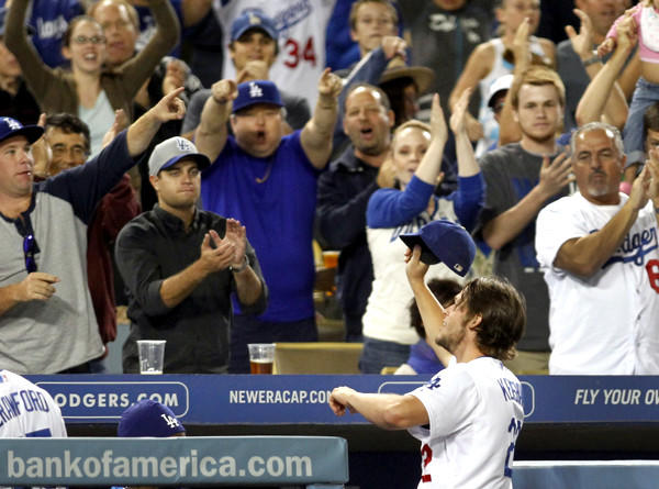 Dodgers ace Clayton Kershaw gets a standing ovation by fans after his dominating six-inning performance Friday night against the Colorado Rockies at Dodger Stadium.