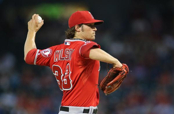 Angels starting pitcher C.J. Wilson walked four in six innings, threw three wild pitches and hit two batters in a 5-3 loss to the Texas Rangers on Friday night.