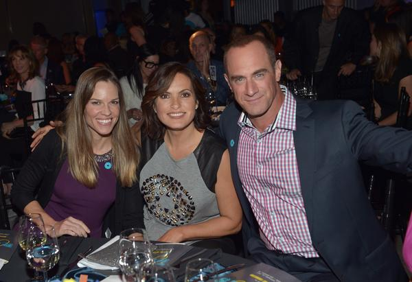 Hilary Swank, left, Mariska Hargitay and Christopher Meloni attend the Joyful Heart Foundation Presents: Joy Rocks on Thursday in Hollywood.