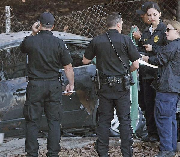 Burbank police investigate the scene of a single-vehicle multiple fatality accident on the southbound 5 freeway at the Scott Road off ramp. The incident was reported early Saturday morning.