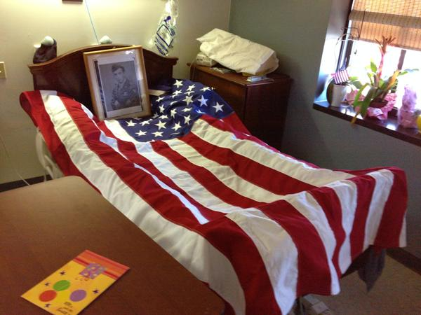 The medical staff at the Home for Heroes hospital at the West L.A. VA draped an American flag over Bernard M. Tuvman's bed after he passed away.