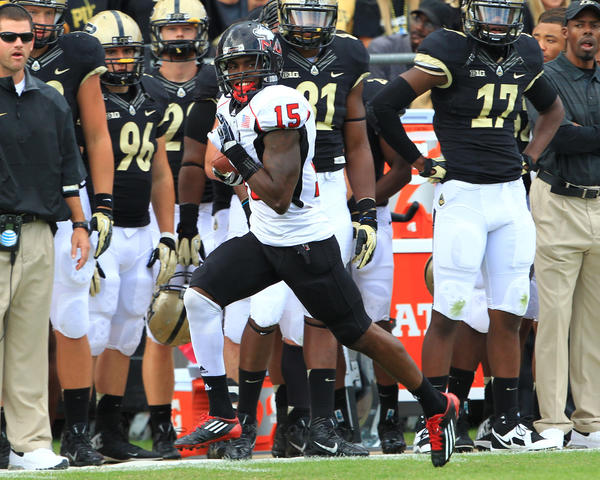 Northern Illinois safety Jimmie Ward returns an interception for a touchdown against Purdue.
