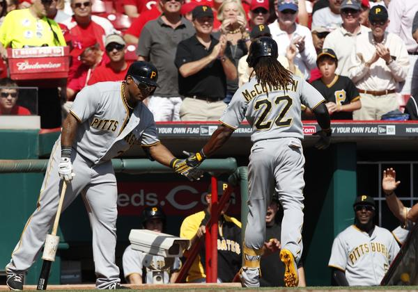 Andrew McCutchen celebrates with Marlon Byrd after hitting a solo home run.