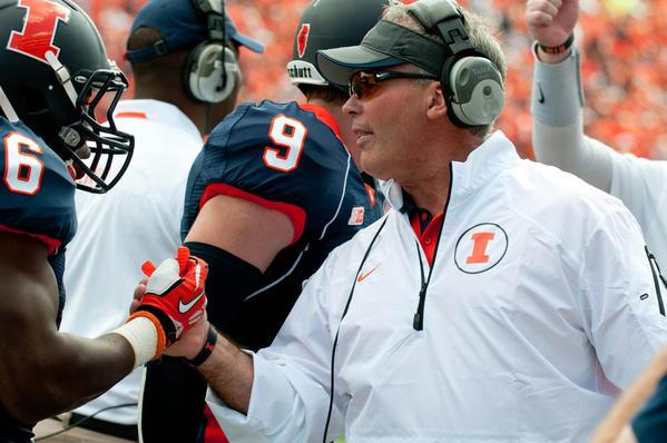 Coach Tim Beckman greets running back Josh Ferguson (6) after Ferguson's touchdown during the second quarter.