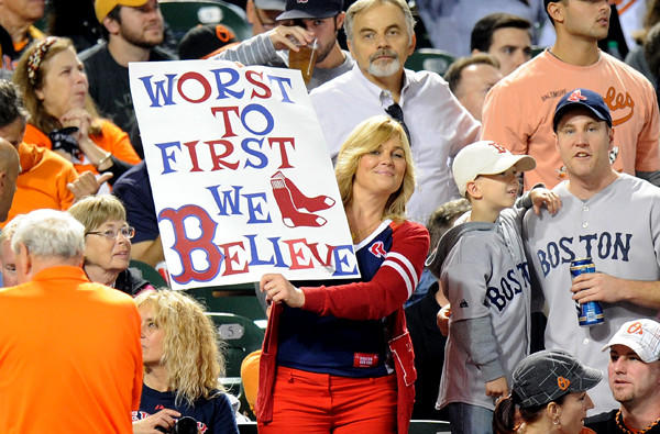 A Red Sox fan holds up a sign during the game against the Orioles on Friday at Camden Yard in Baltimore.