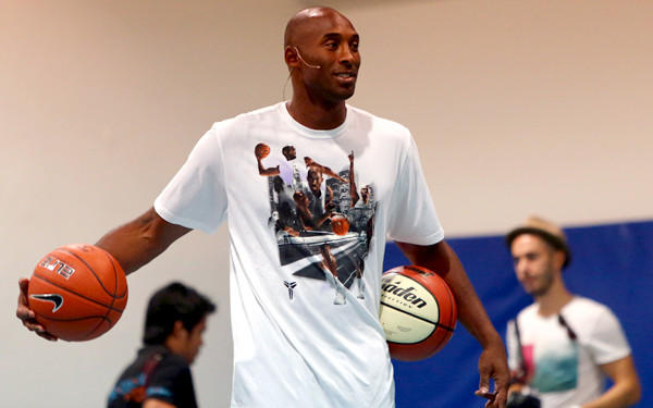 Lakers star Kobe Bryant leads a training session at the Gems American Academy in Abu Dhabi on Tuesday as part of a health and fitness seminar.