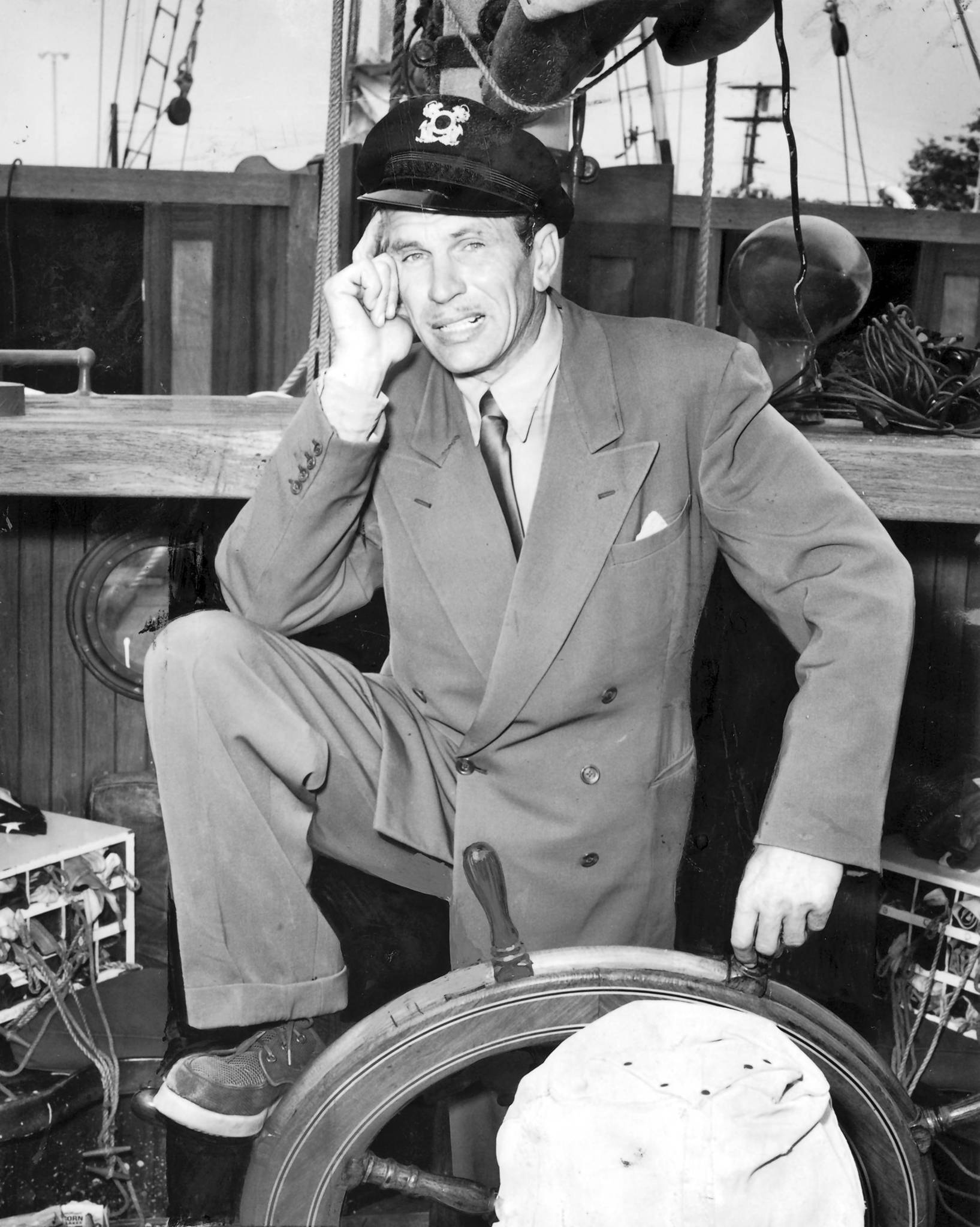 John Calvert -- magician, actor, flier and yachtsman -- at the wheel of Thespian in 1957.