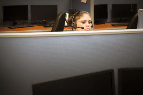 Phone operator Veronica Lopez takes a call inside the call center set up in downtown Hartford to assist people with questions about the Affordable Health Care Plan.