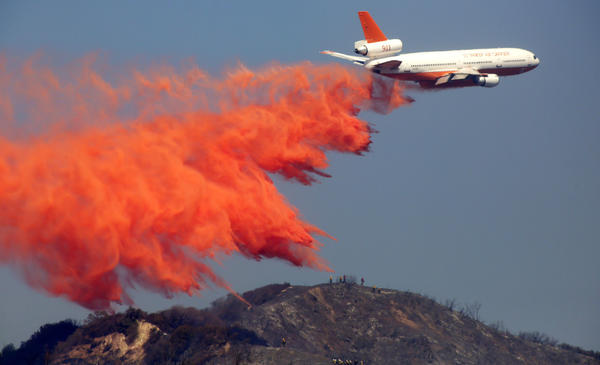 A DC-10 firefighting airplane drops retardant on the Madre fire in the Angeles National Forest above Azusa.