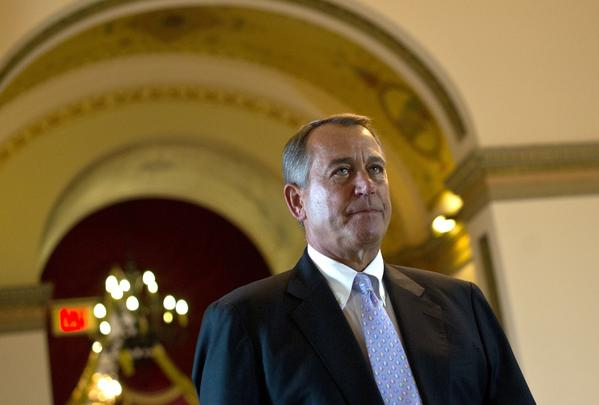 House Speaker John A. Boehner (R-Ohio) arrives at the House chamber, where Republicans were set to try again to stop President Obama's healthcare plan even if their action risks a government shutdown.