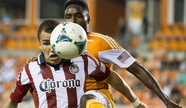 Midfielder Carlos Alvarez gets in front of Houston defender Warren Creavalle to get control of the ball during Chivas USA's loss to the Dynamo, 5-1, on Sept. 21, 2013.