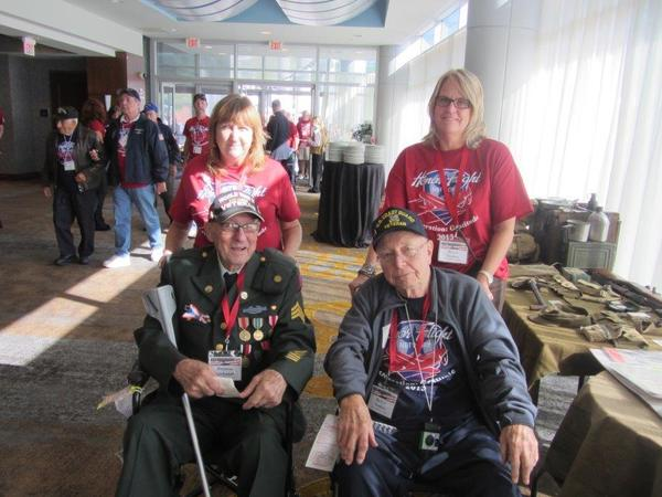 "Veterans Francis Buchanan of Massachusetts, left, and Ballou Tooker of Connecticut were accompanied on ""honor flights"" to BWI Airport and the National War II Memorial in Washington by their daughters, Margaret Flynn and Ferne Tooker."