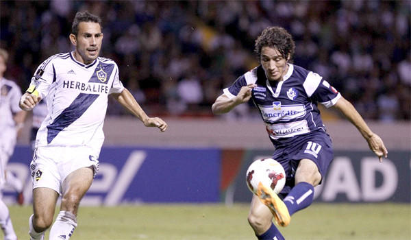 Randall Brenes of Cartagines tries to keep the ball from the Galaxy's Pablo Mastroeni during L.A.'s 3-0 victory over the Costa Rican team on Sept. 25, 2013.
