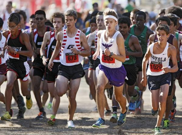 Hoover High's Vladimir Climasevschii, center right, took seventh in his race at the Bellarmine-Jefferson Cross-Country Invitational.