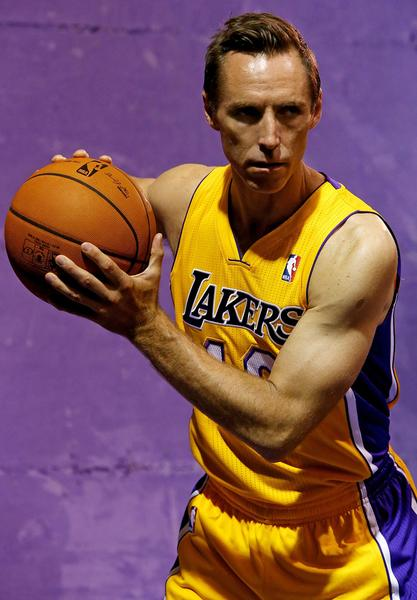 Guard Steve Nash poses for pictures during the Lakers' media day at the team's training facility in El Segundo on Saturday.