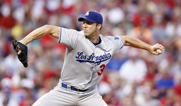 Left-hander Chris Capuano looked sharp pitching for the first time since Sept. 6 in the Dodgers' 11-0 victory over the Colorado Rockies on Friday.
