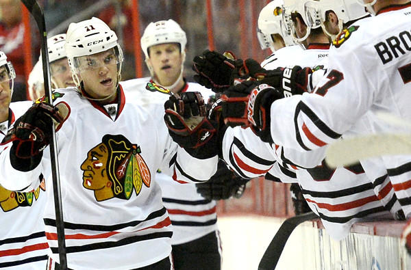 Blackhawks left wing Jeremy Morin celebrates with teammates on the bench after scoring a goal against the Washington Capitals in a preseason game earlier this month.