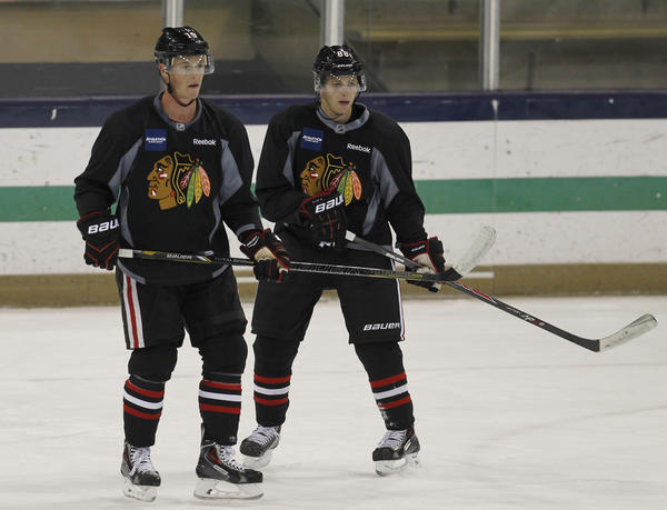 Jonathan Toews and Patrick Kane at training camp practice.