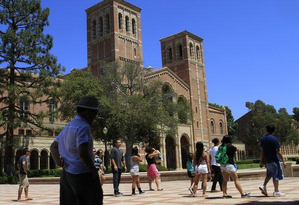Visitors walk on the UCLA campus in Westwood. The College Board has reported that fewer than half of the students of the high school class of 2013 who graduated were prepared for the rigors of college.