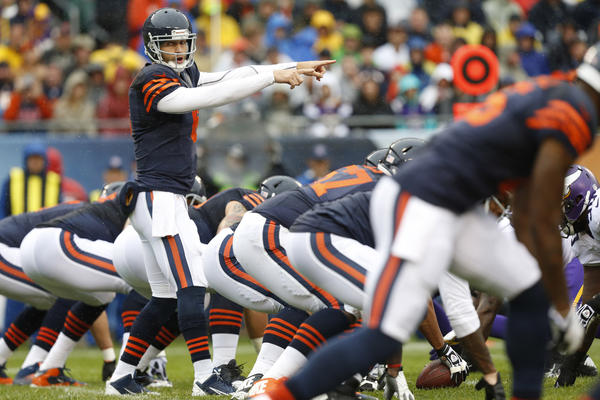 Jay Cutler signals against the Vikings in the first quarter at Soldier Field.