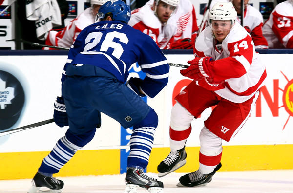 Gustav Nyquist, left, and the Detroit Red Wings head east to play in a new conference agianst the likes of John-Michael Liles and the Toronto Maple Leafs.