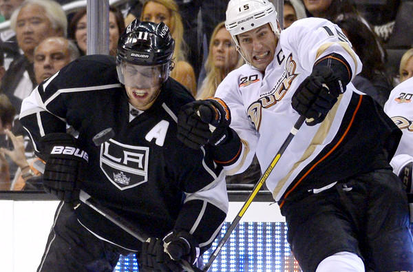 Kings assistant captain Anze Kopitar, left, and Ducks captain Ryan Getzlaf battle for the puck during a preseason game. The two will now be rivals in the West's Pacific Division.