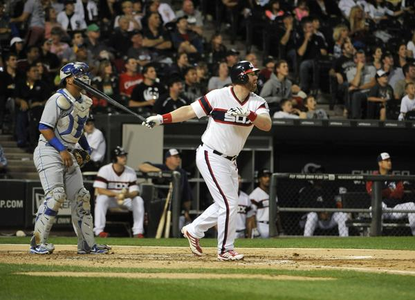 Adam Dunn watches his two-run homer against the Royals during the third inning.