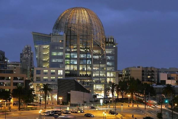 The newly completed San Diego central library, near Petco Park downtown, opens to the public Monday. The nine-story building has a distinctive metal lattice dome over the top floor.