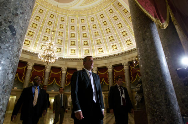 House Speaker John A. Boehner (R-Ohio) walks to the House Floor at the Capitol. Republican lawmakers continued their assault on the Affordable Care Act, voting to delay implementation of President Obama's signature healthcare law.