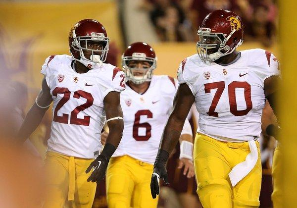 USC running back Justin Davis, quarterback Cody Kessler and offensive tackle Aundrey Walker exit the field after Davis' 26-yard touchdown run against Arizona State.