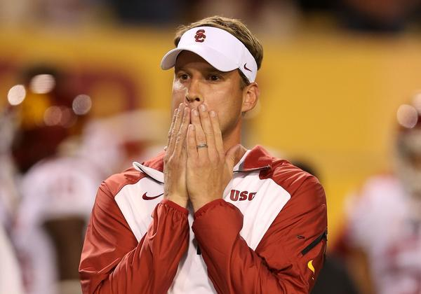 USC Coach Lane Kiffin reacts during the first half of the Trojans' game against Arizona State in Tempe, Ariz. on Saturday.