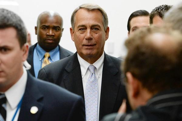 Speaker John A. Boehner (R-Ohio) leaves a meeting with House Republicans, who remain intent on trying to stop President Obama's healthcare law even at the risk of a government shutdown.