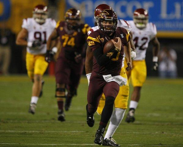 Arizona State quarterback Taylor Kelly runs for a 40 yard gain against USC during the first half on Saturday.