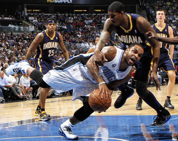 Orlando guard Jameer Nelson (14) is fouled by Indiana forward Solomon Jones (44) during the first half of the Magic's game against the Pacers at Amway Center in Orlando, Fla. Wednesday, April 13, 2011. (Gary W. Green/staff photographer) ORG XMIT: B581184005Z.1