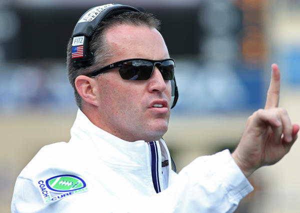 Northwestern coach Pat Fitzgerald motions to a referee.