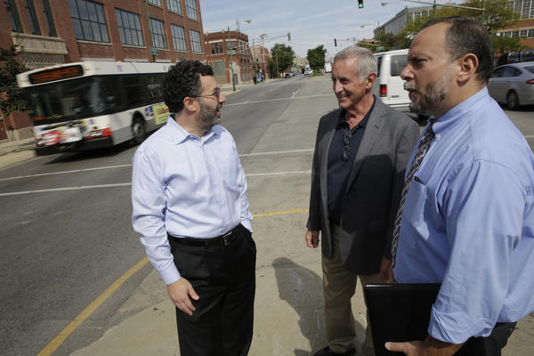 Steve DeBretto, Executive Director of the Industrial Council of Nearwest Chicago, right, talks with business owners Burt Klein of PortionPac Chemical Corporation and James Greenwell of Reliable Plating Corporation, from left, on Ashland Avenue and Fulton Street initial section of the CTA's planned bus rapid transit corridor between Cortland and 31st streets. The Ashland bus rapid transit street design will be eliminating many if not most left turns off of Ashland Avenue angering business owners.