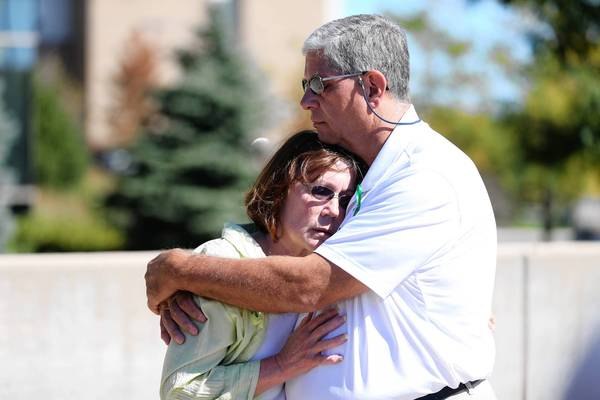 Kathy and Don Steward, of Vernon Hills, embrace as volunteers gather Sunday to search for their missing son, Nick Steward. He disappeared Sept. 20 while on his way home to Lake Villa.