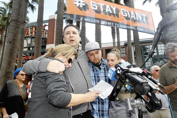 Stabbing victim Jonathan Denver's relatives, from left: Jill Haro, aunt; Robert Preece, father; Robert Preece Jr., brother; and Diana Denver, mother.They gathered with Denver's friends outside AT&T Park.