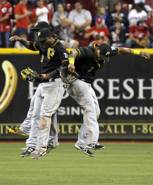 The Pirates' Andrew McCutchen, Starling Marte and Marlon Byrd celebrate.