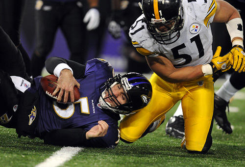 """Joe Flacco is sacked by <a class=""""taxInlineTagLink"""" id=""""PESPT002172"""" title=""""James Farrior"""" href=""""/topic/sports/james-farrior-PESPT002172.topic"""">James Farrior</a>."""
