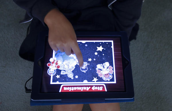 A Southern California student uses an iPad to create an animated cartoon story in a 2011 file photo. In Monterey County's Pacific Grove Unified School District, voters will be asked to pay for such technology with a $28-million bond.