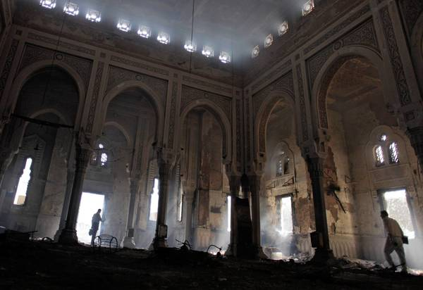 Egyptians tour the charred Rabaa al Adawiya mosque in August, after the military ousted Islamists who had set up camp in the area in Cairo.