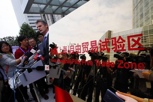 Ralph Haupter, corporate vice president of Microsoft, speaks with reporters at a news conference after the inauguration of the new free-trade zone in Shanghai. The 11-square-mile zone is long on promise and short on detail about how it will boost the Chinese economy.