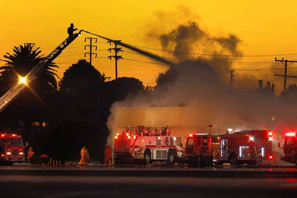 Firefighters battle blaze at Santa Monica Airport. The fire was started when a small jet veered off the runway and crashed into a hangar. The fire spread to two other buildings.