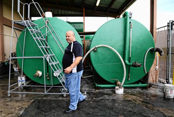 Craig Goldstein, owner of Westway Towing in Lauderdale Lakes in the area where waste vegetable oil is stored for biodiesel-fuel prodution.