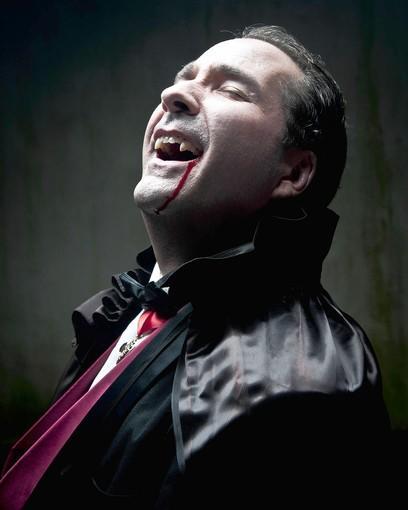 "Michael P. Sullivan in the title role of ""Dracula"" in Chesapeake Shakespeare Company's production of the Hamilton Deane/John L. Balderston adaptation of the Bram Stoker novel."