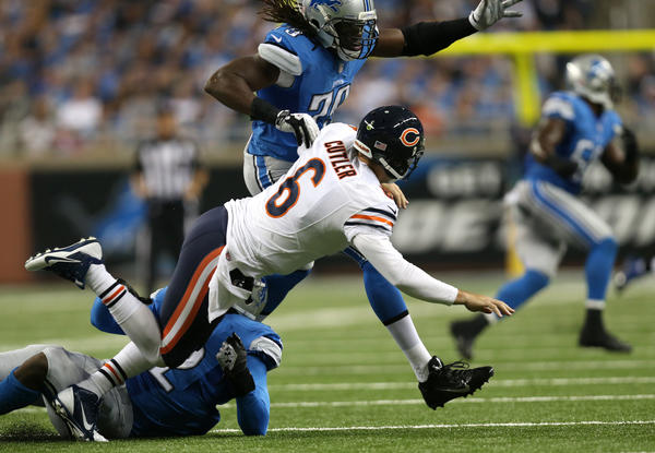 Bears quarterback Jay Cutler is knocked down in the third quarter at Ford Field in Detroit on Sunday.