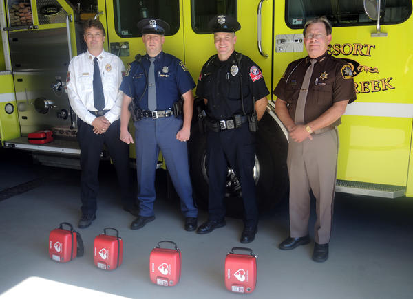 Local departments were able to purchase AEDs with Odawa tribal grant money. Pictured (from left) are Resort Bear Creek fire chief Al Welsheimer, Petoskey state trooper Corey Hebner, Petoskey Public Safety Lt. Rocky Karr and Emmet County Sheriff Pete Wallin.
