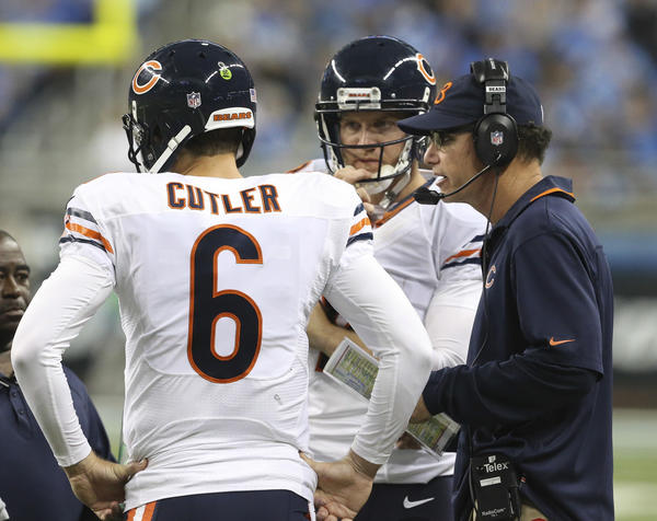 Bears coach Marc Trestman confers with quarterbacks Jay Cutler (6) and Josh McCown during the first half of their game against the Detroit Lions at Ford Field.